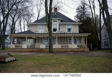 WEQUETONSING, MICHIGAN / UNITED STATES - DECEMBER 22, 2015: The front porch of a Wequetonsing home, christened Marwood, is undergoing off-season renovation.