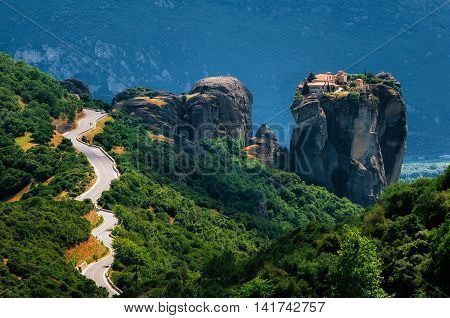 The curve road to Holy Trinity Monastery. Panoramic view of landscape of Meteora Greece