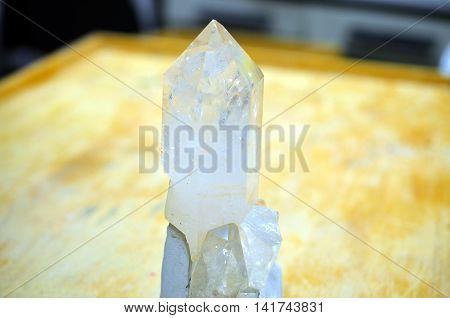 large crystalized quartz mineral on wooden background