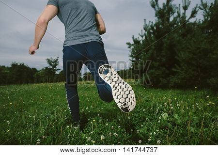 Jogging Lifestyle - Young Attractive Man Running In Park