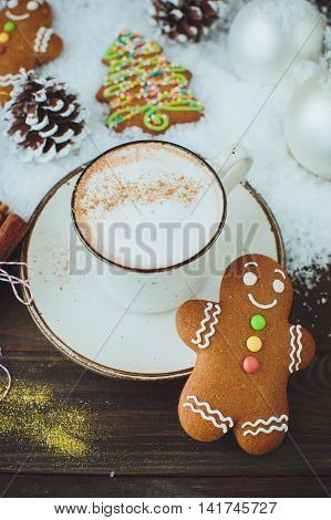 Hot Chocolate Or Cocoa Beverage With Cinnamon And Gingerbread Man Cookie In Snowon Vintage Wooden Ta