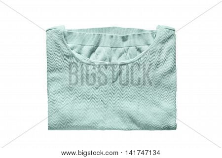 Folded blue knitted pullover isolated over white