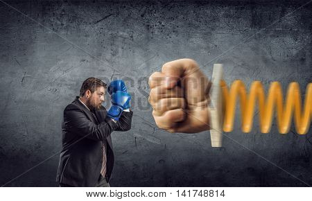 Businessman fighting jack in the box . Mixed media