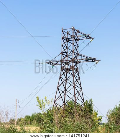 Electricity pylons bearing the power supply across a rural landscape