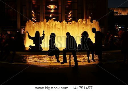 Silhouettes by the fountain at Lincoln Center in New York City