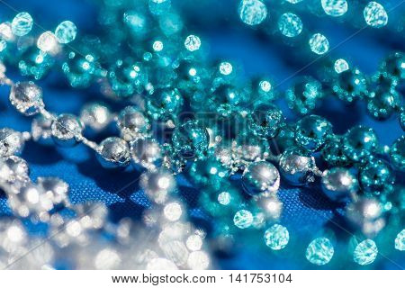 Abstract blue and white twinkled lights background with bokeh defocused