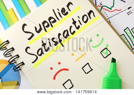 Sign supplier satisfaction on a page of notebook.