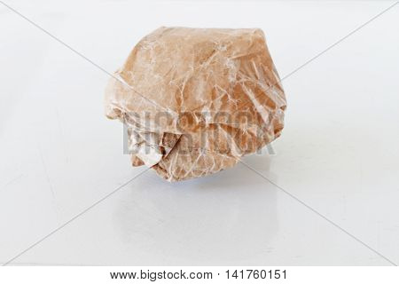 Close-Up Of Crease Crumpled Paper Isolated On White.