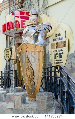 VITEBSK BELARUS - JULY 13 2016: Figure of medieval knight in armor at entrance to club-restaurant