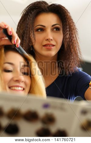 Portrait Of Beautiful Smiling Brunette Hairdresser
