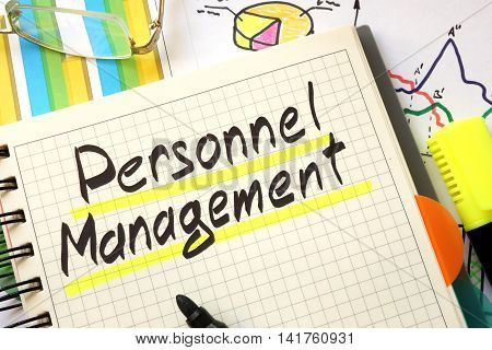Sign personnel management on a page of notebook.