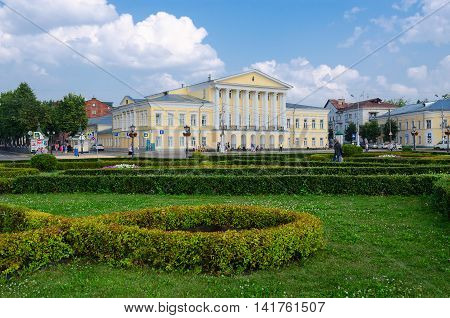 KOSTROMA RUSSIA - JULY 20 2016: Unidentified people walk on Susaninskaya square near House of General Borshchov in Kostroma Golden Ring of Russia