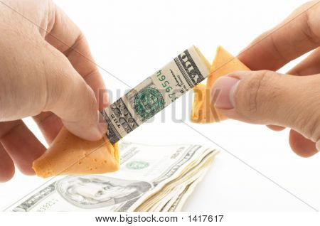 Pair Of Hands Opening A Fortune Cookie With Cash, Money Inside,