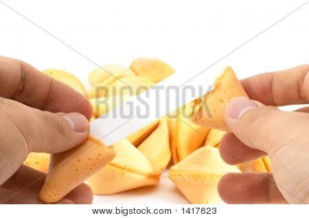 Pair Of Hands Opening A Fortune Cookie With Blank Label,