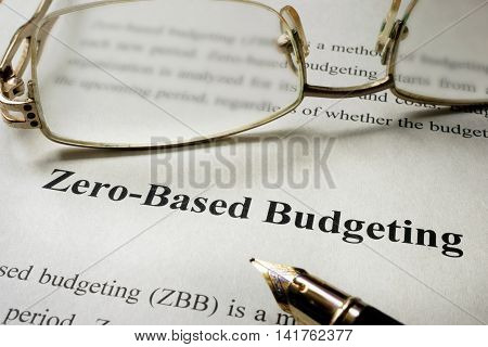 Sign Zero-Based Budgeting - ZBB on a paper and glasses.