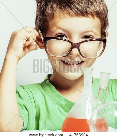little cute boy with medicine glass isolated wearing glasses smiling close up