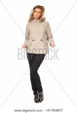 Beautiful woman in beige winter coat isolated