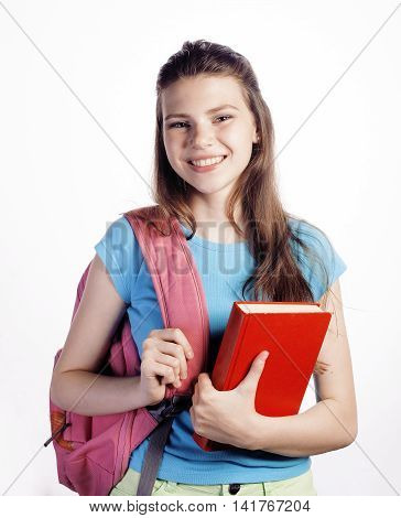 young cute teenage girl posing cheerful against white background with books and backpack isolated
