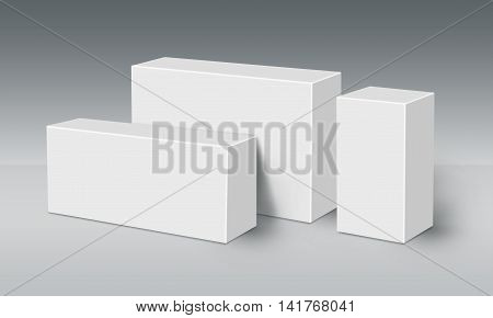 Three 3D White Boxes on Ground Mock Up Template Ready For Your Design Clipping Path Included.