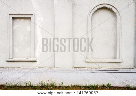 Detail of an old white cement wall texture
