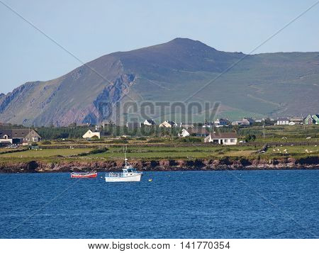 Coastline with a fishing boat in Dingle, Ireland