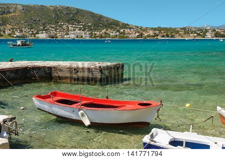 Porto Rafti harbor view with fisher boats during summertime, Greece