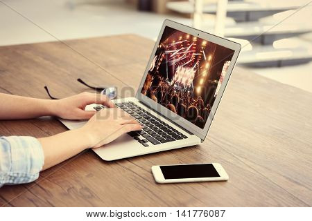 Woman using laptop at the table