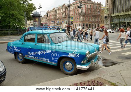 05.08.2016.Russia. Saint-Petersburg. On the old car the travel Agency has placed its advertising.