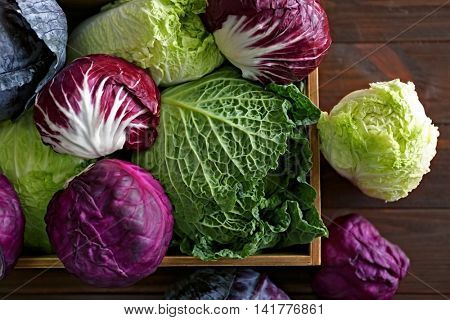 Fresh cabbage in wooden crate, closeup