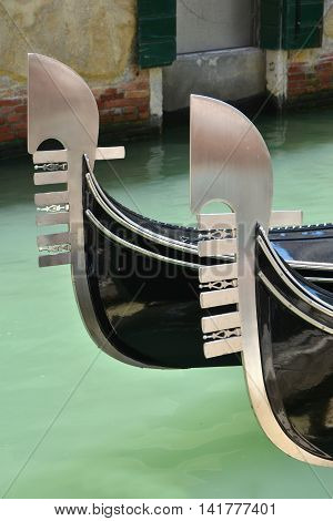 Two 'Ferro' gondola typical iron bow symbolizes Venice city districts and Doge hat