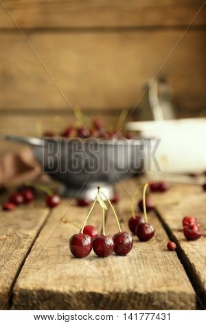 Few cherries on wooden table, closeup