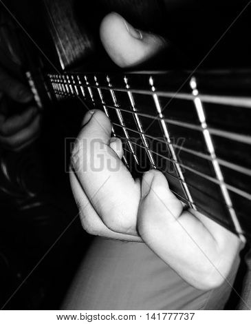 Performed composition of a musical instrument in black and white effect.