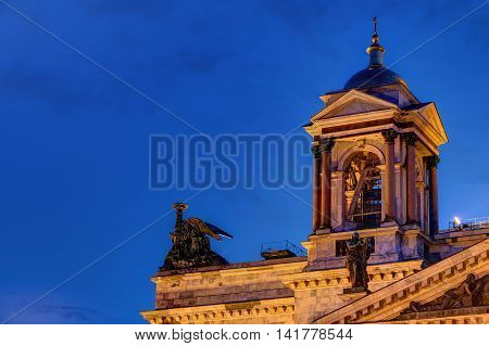 Bell tower on the corner of roof of the Saint Isaac's Cathedral on the background of the night sky St. Petersburg Russia