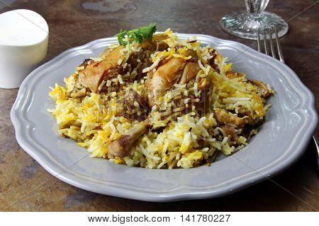 A plateful of Chicken Biryani an Indian rice meal with spicy Chicken marinated in yogurt selective focus