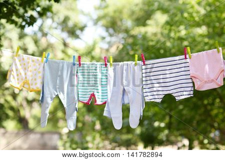 Baby clothes hanging on clothesline