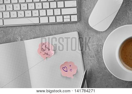 I love my job concept. Open notebook with cup of coffee on table