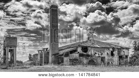 Black and White photo of a derelict tile factory which is now abandoned.
