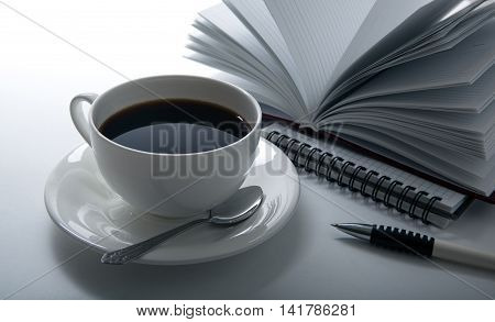 cup of coffee and business diary close up