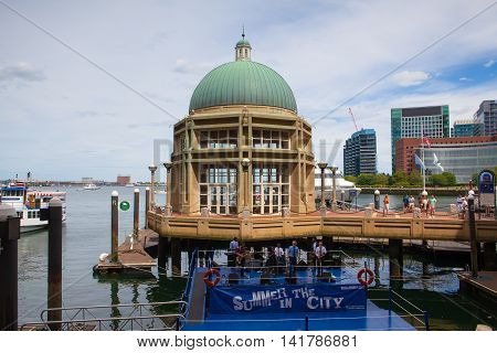 BOSTON,MASSACHUSETTS,USA - JULY 2,2016: View of Boston from harbor and rowes wharf at sunset