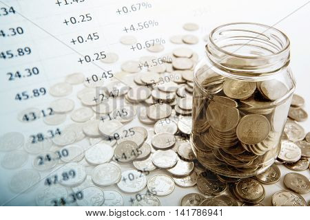 bank with coins and counting close up