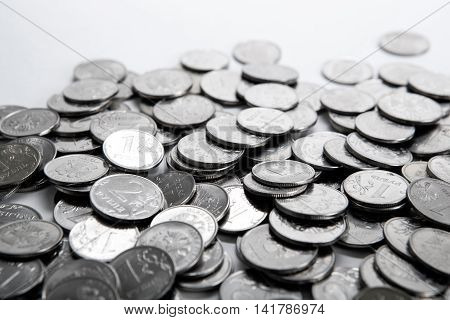pile of coins on a white close up