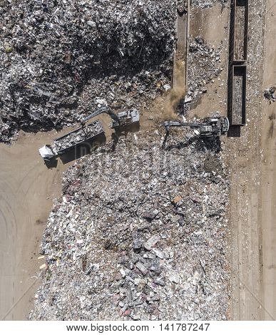 Iron Raw Materials Recycling Pile, Work Machines. Metal Waste Junkyard. View From Above.