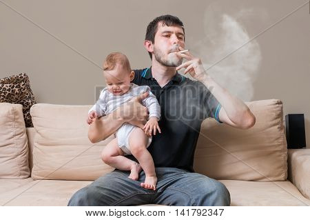 Bad Father Is Smoking And Holding Baby. A Lot Of Smoke Around.