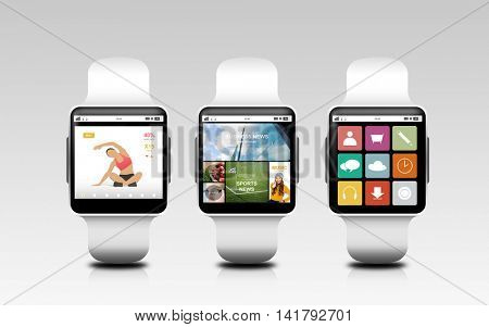 modern technology, object and media concept - smart watches with applications on screen over gray background