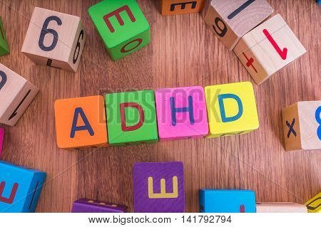 Adhd Concept. Word Written With Colorful Cubes With Letters.