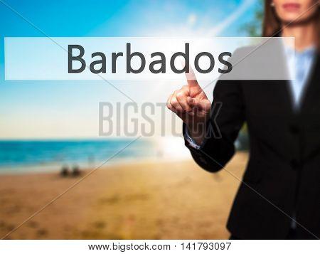 Barbados - Female Touching Virtual Button.