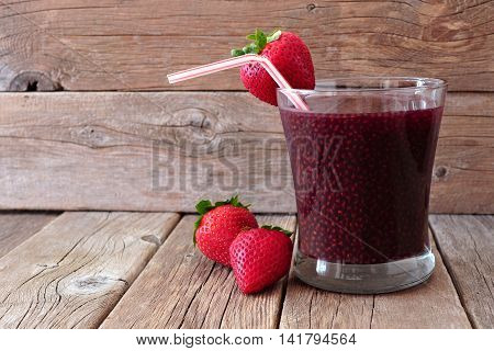 Healthy Strawberry Chia Seed Drink On A Rustic Wood Background