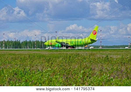 SAINT PETERSBURG RUSSIA -MAY 11 2016. VP-BND S7 Siberia Airlines Boeing 737 Next Gen airplane is riding on the runway after landing in Pulkovo airport. S7 Siberia is Russian largest domestic carrier