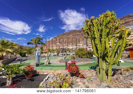 TAURITO, GRAN CANARIA, SPAIN - APRIL 20, 2016: Architecture of the Lago Taurito aquapark and hotels on Gran Canaria, Spain. Taurito is very popular tourist destination with many shops and hotels.