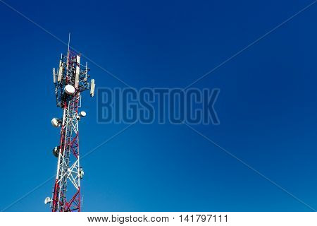 Cell Phone Antenna Tower With Blue Sky Background